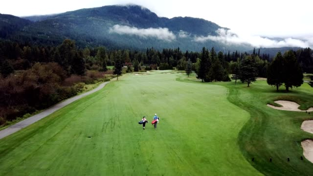golfers walking the course - golf course stock videos & royalty-free footage