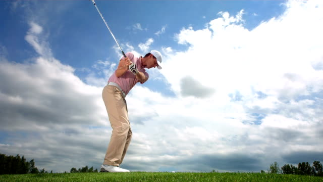 hd slow motion: golfing with iron on fairway - golf swing stock videos & royalty-free footage