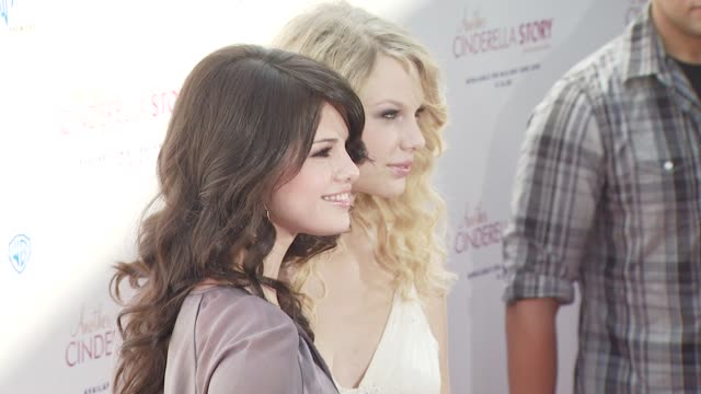 d12 gomez taylor swift selena gomez at the the premiere of warner premiere's another cinderella story at los angeles ca - cinderella stock videos & royalty-free footage