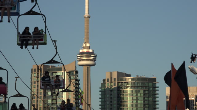 Gondola lift and the CN Tower. Recreation at Canada Exhibition Place at Dusk