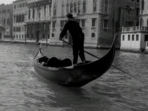 A gondola moves along a canal in Venice