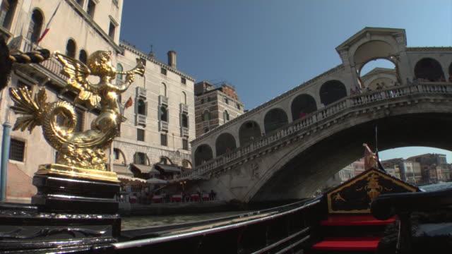 pov, gondola on grand canal passing under rialto bridge, venice, italy - 16th century style stock videos & royalty-free footage