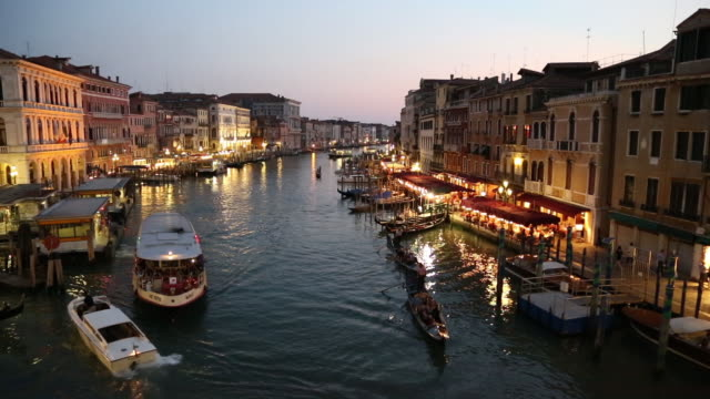 gondolas and a vaporetto on the grand canal at night - grand canal venice stock videos & royalty-free footage