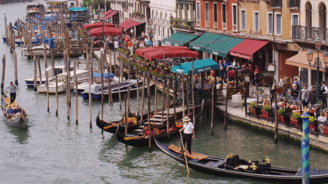 MS, HA, Gondolas and crowded restaurants by Grand Canal, Venice, Italy