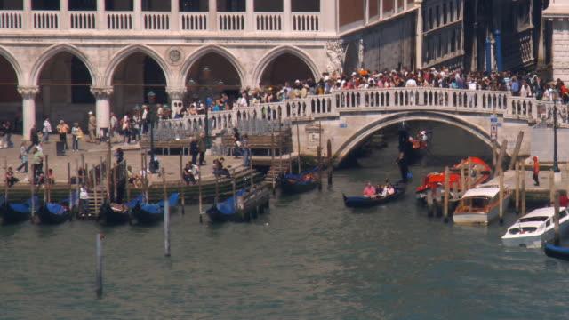 ms, ha, gondolas at crowded ponte della paglia, venice, italy - ponte stock videos & royalty-free footage