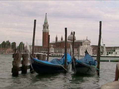 gondolas balancing in st. mark's quartier, venice - anchored stock videos & royalty-free footage