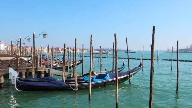 gondolas docked in venice, italy - clear sky stock videos & royalty-free footage