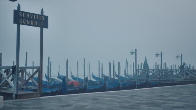 ws - gondolas in the mist near st. mark's square - western script stock videos & royalty-free footage