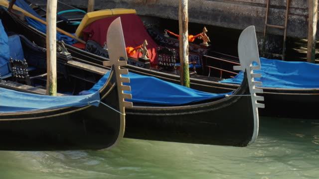 CU, Gondolas moored in canal, Venice, Italy