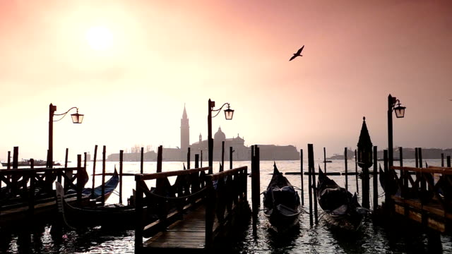 hd gondolas on the lagoon at sunset  - slow motion - grand canal venice stock videos & royalty-free footage