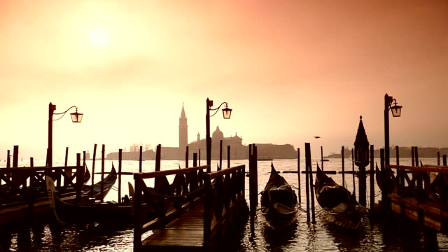 hd gondolas on the venetian lagoon mammuth - slow motion - grand canal venice stock videos & royalty-free footage