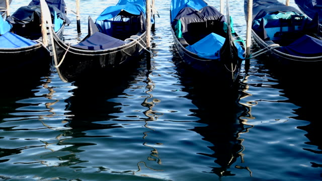 gondolas on the venetian lagoon - italian culture stock videos & royalty-free footage