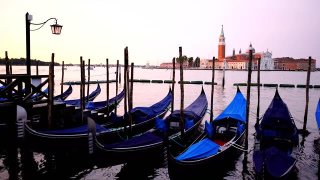 gondolas with san giorgio di maggiore church in venice, italy - venice stock videos and b-roll footage