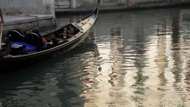 WS Gondolier Rowing down Canal / Venice, Italy