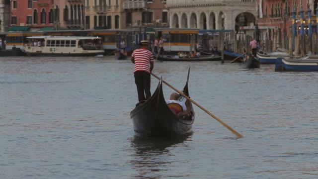 WS LD Gondolier Rowing Gondola down Grand Canal / Venice, Italy