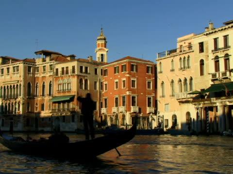WS Gondolier rowing gondola on Grand Canal / Venice, Italy
