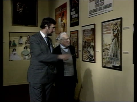 50th anniversary itn rees and frank garrett looking at posters on wall cms frank garrett intvw sof margaret mitchell did expect the book to sell - poster wall stock videos & royalty-free footage