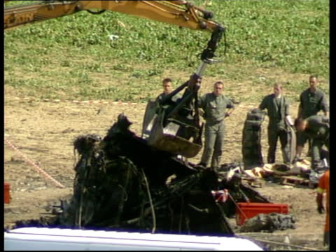 gv crane lifting up section of wreckage from crashed air france concorde gv crash investigators removing wreckage - british aerospace concorde stock videos & royalty-free footage