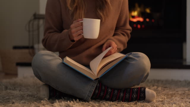 good coffee and a great book…life's perfect - cosy stock videos & royalty-free footage