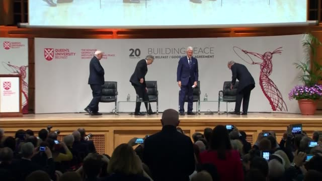 architects come together to commemorate deal queens university belfast int wide shot stage tony blair bertie ahern bill clinton and george j mitchell... - バーティ アハーン点の映像素材/bロール