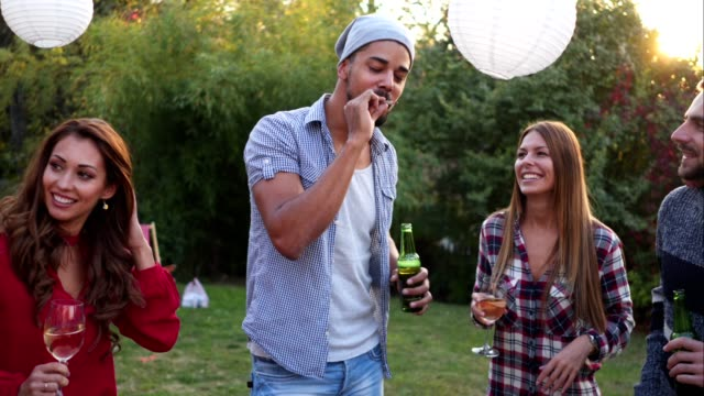 good friends smoking and drinking at a party - youth culture stock videos & royalty-free footage