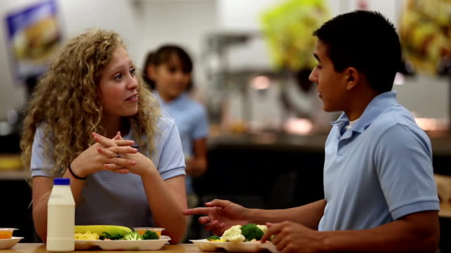 stockvideo's en b-roll-footage met good friends talking in school cafeteria - kantine