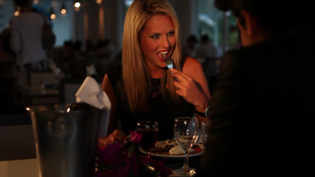 good looking couple have lover's dinner - shy stock videos & royalty-free footage