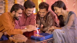 Good looking office colleagues using an application or shopping online on a cell phone during Diwali