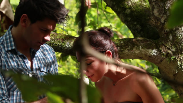 vidéos et rushes de good looking young couple in a plantation cocoa - chocolat chaud