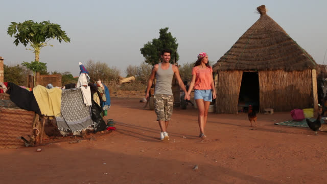 good looking young couple in rural african village - hamlet play stock videos and b-roll footage