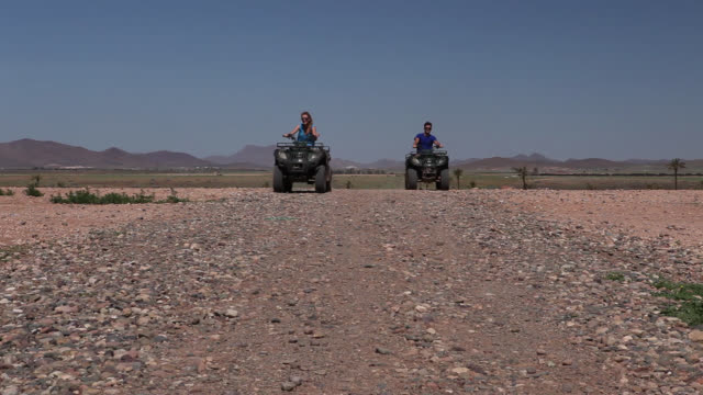 good looking young couple ride quad bike - quadbike stock videos & royalty-free footage