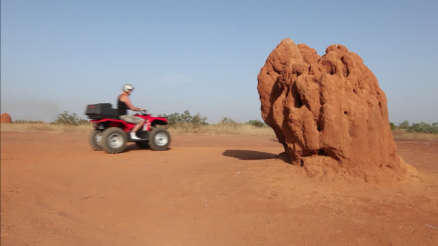 good looking young couple ride quad bikes and buggy - quadbike stock videos & royalty-free footage
