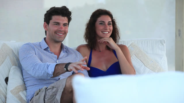 good looking young couple talk with someone off camera - punta cana stock videos and b-roll footage