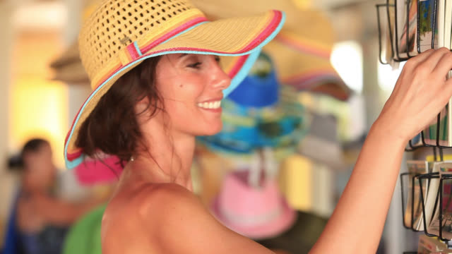good looking young woman smiles as she shops on holiday - punta cana stock videos and b-roll footage