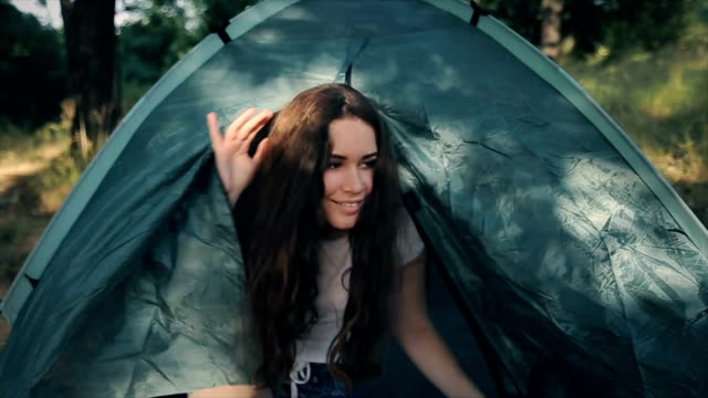Good morning nature,young teenage girl wake up in the tent