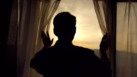 vídeos de stock e filmes b-roll de good morning,man hand open curtain - young men