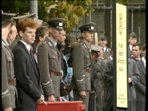 good views and close ups of people and soldiers lining street waiting for mikhail gorbachev to arrive on visit to berlin for 40th anniversary... - parade stock videos & royalty-free footage
