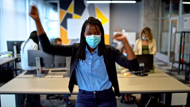 good work - excited  team leader stands in her office in front of the colleagues  and looking at the camera - thumb stock videos & royalty-free footage