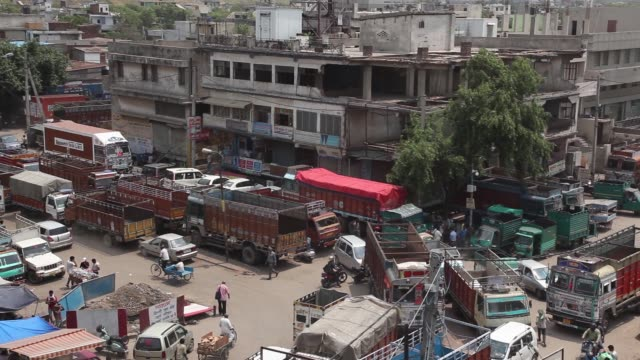 a goods carrying tricycle passes trucks standing idle due to a lack of qualified drivers outside the caravan roadways ltd office at sanjay gandhi... - tricycle stock videos & royalty-free footage