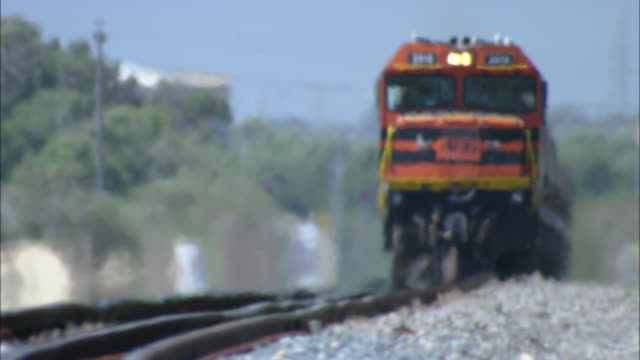 a goods train moves towards the camera.  - railway track stock videos & royalty-free footage
