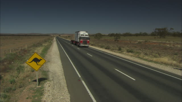 A goods truck travels along a highway in Southern Australia.