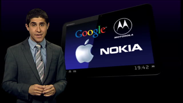 vídeos y material grabado en eventos de stock de google buys motorola mobility; reporter to camera in front of videowall close up of android smartphones professor jeff jarvis skype interview sot... - motorola
