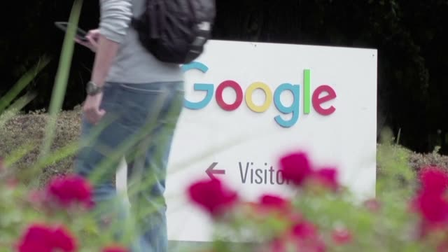 google's parent company alphabet beats expectations with $89 bn profit - google stock videos & royalty-free footage