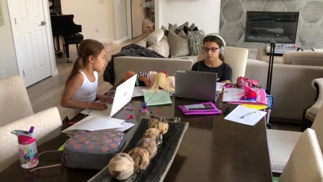 vídeos de stock e filmes b-roll de goolsby elementary school fourth grader luca conrad does independent study work at her home during the first week of distance learning for the clark... - veículo de construção