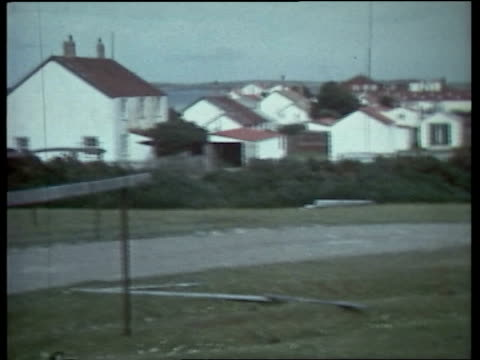 islands goose green 23582 military hold lms pan goose green rough street lr – buildings seen in background pike 20secs tx archive tape 20073 1710... - フォークランド諸島点の映像素材/bロール
