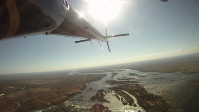 gopro footage from a helicopter of the zambezi river - helicopter rotors stock videos and b-roll footage