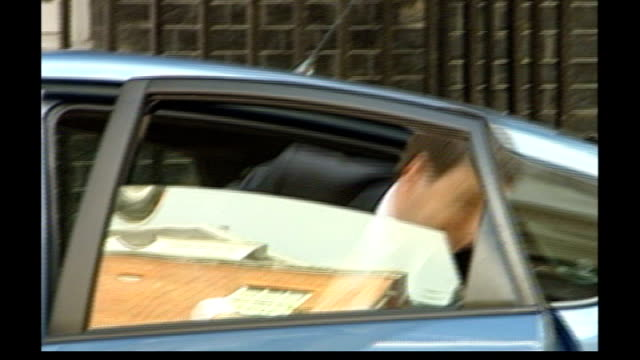 gordon brown aide comments on britian's 'special relationship' with usa; lib downing street: ext douglas alexander mp out of car and into number 10 - douglas alexander stock videos & royalty-free footage