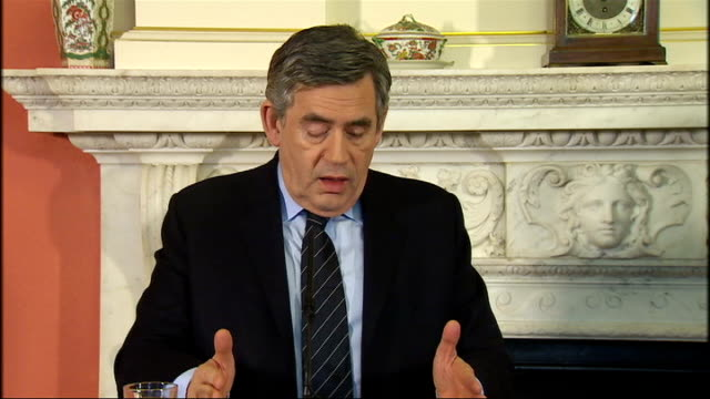 gordon brown and brian cowen press conference at downing street gordon brown press conference continues sot we will do everything we can for haiti /... - イスパニョーラ点の映像素材/bロール