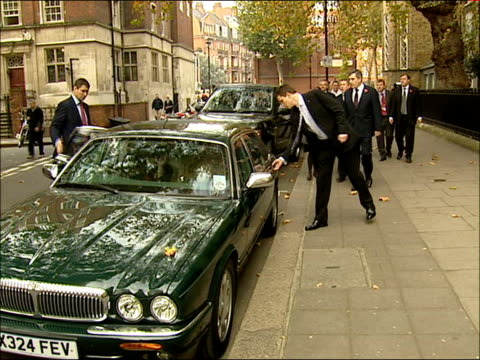 gordon brown and ed balls meet apprentice chefs at westminster kingsway catering college ext brown along getting into car and being driven away - gordon brown stock videos & royalty-free footage