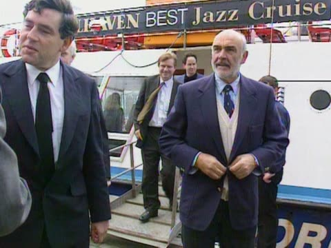 gordon brown and sean connery disembark from a boat at edinburgh for a pro-devolution campaign. - sean connery stock videos & royalty-free footage